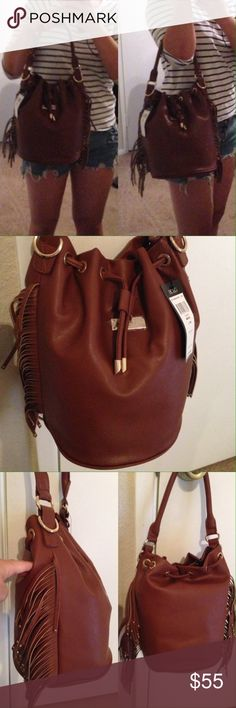 BCBGParis Side Fringe Bucket Tote NEW WITH TAGS Authentic BCBG Paris Mocha Side Fringe Bucket Tote + Removable strap.          🚫No Trade🚫  High in volume and amped with style, this fringe number gives that rocker-chic vibe and totes your essentials in organized style thanks to convenient interior pockets.  • MSRP $145.00 • 8.5'' W x 11'' H x 8'' D  • 44.5'' adjustable removable strap(max. strap length)  • 6.25'' handle drop • Drawstring and Magnetic snap closure • Interior: one zip pocket…
