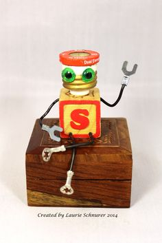"""Super Fusetron"" ~ Original junk art sculpture created by Laurie Schnurer in 2014. The wooden box opens to store treasures inside. To purchase one of Laurie's Creatures click on this link to her sales page. https://www.facebook.com/LauriesCreatures/"