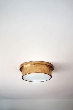 Brass Flush Mount Light Fixture (via @Home Depot) quite teh deal.