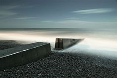 Broken Groyne a moonlit long exposure photograph by AlexBamford
