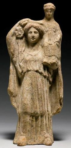 Demeter standing with Persephone sitting on her left. Antiquities from the Erlenmeyer Collection, Sotheby's, London