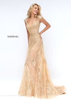 Project an aura of whimsy in the Sherri Hill 50176 lace prom dress. This flowing gown features a mid-thigh silhouette embellished with beaded lace. It features a plunging V-neckline with sheer modesty inset, scalloped edged cap sleeves and deep V-back. A sheer illusion lace long overlay skirt cascades over the short hem finishing in a lace border hemline and sweep train.