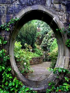 Gateway to the Faeries. I like this idea. I can put a round cutout in my fence and then decorate and plant around it to semi-conceal it. Give it a secret magical appeal!  :-)