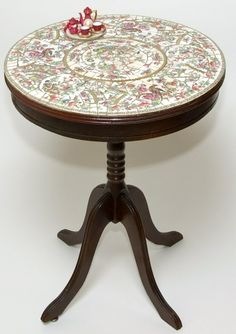 """Antique mahogany table with mosaic table top by Nancy Low.  Predominant porcelain """"Indian Tree"""" by Johnson Pros. England with a tiny burgundy tea service set enhancing the table's edge. SOLD"""