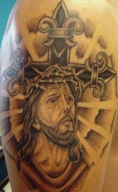 Jesus and a cross tattoo