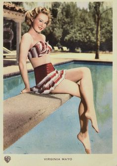 https://flic.kr/p/Naeyp4 | Virginia Mayo | Vintage postcard by GM. Photo: Warner Bros.  American actress and dancer Virginia Mayo (1920-2005) is best known for her series of film comedies with Danny Kaye, including Wonder Man (H. Bruce Humberstone, 1945), The Kid from Brooklyn (Norman Z. McLeod, 1946), and The Secret Life of Walter Mitty (Norman Z. McLeod, 1947). The popular actress personified the dream girl or girl-next-door and audiences—particularly males—flocked to theatres just to see…
