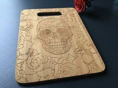 Presenting our personalized, laser engraved bamboo cutting board. This type of cutting board is great for gifting at weddings, anniversaries, and Sugar Skull Decor, Sugar Skulls, Goth Home, Diy Cutting Board, Flower Girl Gifts, Flower Skull, Gothic House, Skull And Bones, Skull Art