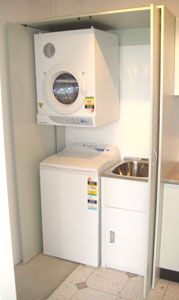 Pocket door to hide the dryer, tub and washer. This would work perfectly in our laundry!
