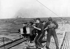U-Boats ~ Naval warfare U-Boat crew members at the deck gun of a surficed submarine ~ Getty Images ~ BFD