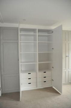 Built in wardrobes: half drawers & shelves, half hanging. Sliding mirror doors