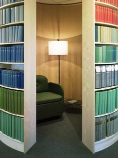 """Svensk Travsport Offices / Note Design Studio"" -- Click through to see more of these cool hidden nook round bookcases!"