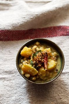 Pumpkin Erisseri – a mild and tempered curry with light sweet tones made with pumpkin, cowpeas and coconut. (Kerala)