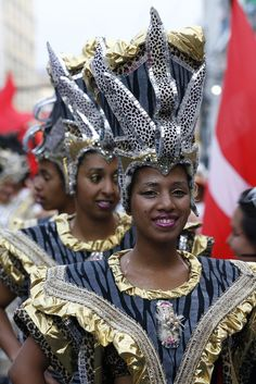 """(Uruguay) Members of a """"comparsa"""", an Afro-Uruguayan rhythm carnival group, dance and play candombe during a Carnival."""