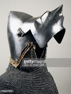 Photo : Beaked visor, open, detail from bascinet with pig faced snout (visor) and chain mail, 1350-1360, made in Milan, Italy, 14th century