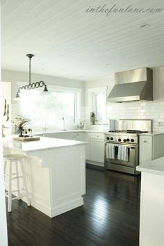 white kitchen/dark floors/light countertops