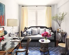In this Manhattan study, a daybed by Ballard Designs is covered in a Rogers & Goffigon linen, the desk is by Williams-Sonoma, and the rug is by Madeline Weinrib; the silver-leafed wood chair and mirrored consoles are from David Duncan Antiques. Tour the entire home.   - ELLEDecor.com