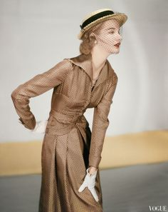 Sunny Harnett, Wearing a Jose Martin Suit; Silk Twill in Cocoa with Black Miniature Prints - Vogue feb 1951  © Horst P. Horst