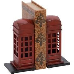 "Set of two weathered metal bookends with British telephone box designs.   Product: Set of 2 bookends Construction Material: Metal Color: Red     Dimensions: 9"" H x 4"" W x 4"" D each Cleaning and Care: Wipe with dry cloth"
