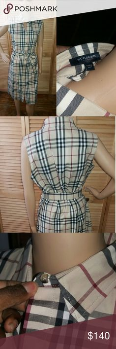 Authentic Burberry Sheath Dress With Belt NEW WITH TAGS Classicly slaying. The iconic Burberry print is an staole this 83%cotton 15%nylon  and 2%elastane dress is a gem.Dry clean only and super strecthy. The belt is removable.The only flaw is a chipped button at the collar that is not noticeable.  Pair with a red heel for an statment look. Button closure line the front. Burberry Dresses