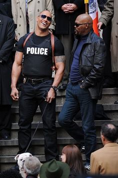 Dwayne Johnson aka The Rock and Samuel L Jackson in police uniforms share a laugh on the set of The Other Guys.
