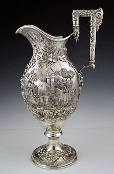 Kirk antique sterling silver pitcher with landscape chased pattern