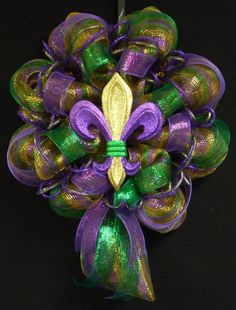 Its Mardi Gras Time! This wreath is big and beautiful! This custom poly mesh wreath was made using gold poly mesh with lots of emerald green and