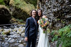 bride and groom smiling after ceremony in remote Northwest forest @myweddingdotcom