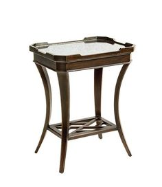 Oliver End Table This rectangular table features an antiqued mirror top surrounded by a distinctive crenelated gallery. Tapering saber legs are tied together with a Chippendale fretwork shelf.