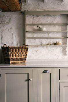 A beautiful wicker basket in a lovely deVOL Shaker kitchen