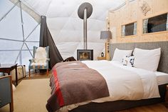 Each of the geodesic-dome shaped pods are fully furnished, and offer a view directly from the bed. The domes have all of the modern amenities you would find in other hotel rooms, like a television, fireplace, desk and sitting area.A family pod is similar to a standard pod however you can accommodate 2 children on the mezzanine.