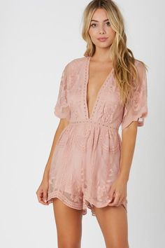Delicate lace and crochet romper with short sleeves and plunging V-neckline. Hidden back zip closure with lining for coverage at bust and bottom. - Self: 100% Polyester - Lining: 100% Polyester - Impo