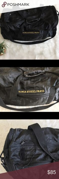 Vtg Sonia Rykiel Paris Nylon Logo Duffle Gym Bag Vintage Sonia Rykiel Paris Black Nylon Quilted Logo Duffle Gym Travel Bag  100% authentic  See all photos, which include measurements and flaws. Adjustable strap. Larger sized.  Vintage pre-loved item in good condition. Nylon is in great condition. All four corners of the bottom of the bag show wear as pictured. Still sturdy and an awesome addition to any closet.   Quick shipping! WE SHIP EITHER THE SAME BUSINESS DAY OR NEXT. ORDERS ON…