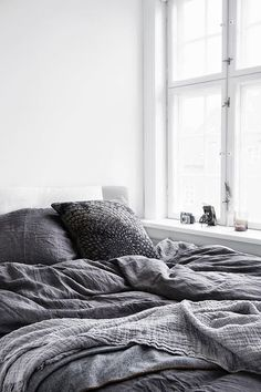 Grey bed and white room
