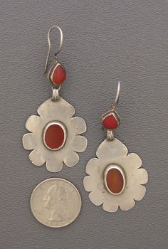 Very old lightweight carnelian and silver earrings from the Ersari,  a Turkman tribe that makes jewelry that is much more subdued than those found in other Turkmen tribal traditions.   195$