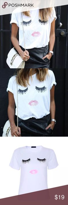 💋WHITE EYELASHES AND LIPS SUPER SOFT TEE- NEW💋 💋OBSESSED💋RUNS SMALL💋UNBELIEVABLY ADORABLE EYELASHES AND PINK LIPS SHORT SLEEVE TEE. SUPER SOFT. EYELASH TEE. GRAPHIC OR GRAFFIC TEE. THESE RUN SMALL SO WE RECOMMEND GOING UP A SIZE AND MAYBE EVEN TWO FOR A LITTLE EXTRA ROOM. GREAT FOR FESTIVALS AND LOOK REALLY GOOD WITH THE PINK LACE SHORTS IN OUR CLOSET💋 Boutique Tops Tees - Short Sleeve