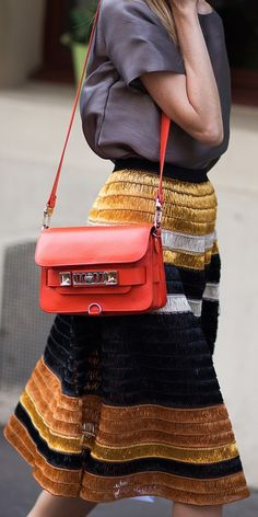 Get in the Fall Halloween spirit with an orange Proenza Schouler bag. Click to see more.