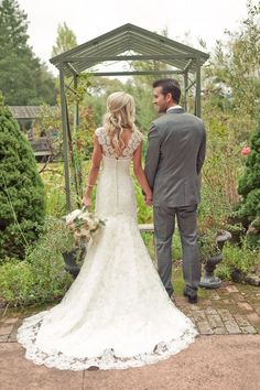 Beautiful mermaid style lace wedding dress. Also like the groom in grey, especially for Summer.