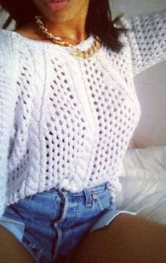 Knit sweater and chain necklace.