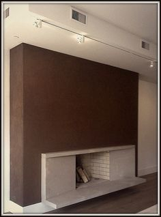 Fireplace with stucco application in Manhattan apartment by Urban Walls Design Systems.