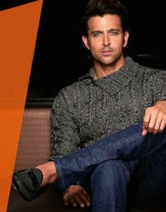 The woven grey sweater with asymmetrical collar pairs well with the embellished loafer. The indigo jeans are un petit gauche. // GQ India Nov 2013 Hrithik Roshan