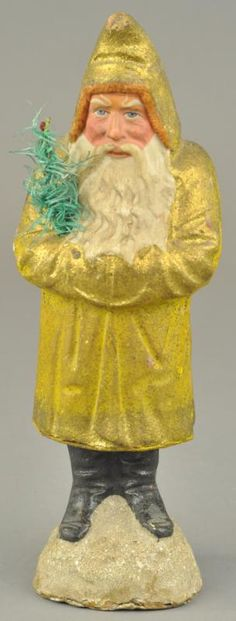 GOLDEN ROBE BELSNICKLE CANDY CONTAINER for auction. Germany, composition Santa standing on a snowball, wearing a gold flecked robe with red chenille trim hood, holding a feather tree sprig. Some minor re-gluing to base, (Good-VG Cond. Antique Christmas, Christmas Past, Primitive Christmas, Vintage Christmas Ornaments, Father Christmas, Christmas Candy, Christmas Wishes, Christmas Colors, All Things Christmas