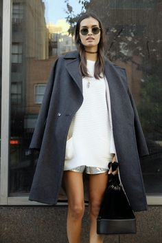 White top, charcoal coat, choker, and round sunnies.