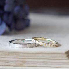 お二人それぞれのデザインでお作りした結婚指輪。男性は、プラチナの平打ちリング。 表面をつや消しヘアライン仕上げで、両端にミルグレインを入れました。女性はダイヤモンドのフルエタニティーリング [Pt900,K18,diamond,wedding,marriage,ring,jewelry]