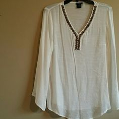 Tunic top light weight tunic top. Beautiful design on neck area. Embellishments adorn new direction  Tops Tunics