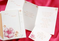 Perfect for your destination wedding! Groups of hot pink and tangerine hybiscus grace this bright white invitation.