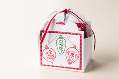 Gift packaging is easy to make using the Scalloped Tag Topper punch and the Christmas Cheer stamp set.