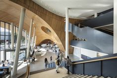 A curved wooden entrance is carved into the corner of this university library that Snøhetta has completed on Temple University's campus in Philadelphia. Atrium, Contemporary Architecture, Interior Architecture, Interior Design, Amazing Architecture, Scandinavian Architecture, Public Architecture, Casablanca, Libraries