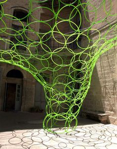 Organic hoop sculpture in 18th century courtyard.