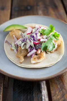 A lightly fried fish tacos recipe that features spiced walleye and topped with a tangy cilantro lime coleslaw. Fresh and easy to prepare!