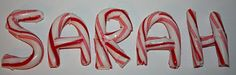 Reshaping Candy Canes ~ line a baking sheet with parchment paper, place candy canes on top, and put it in a low oven (she did 300 degrees for about 6-7 minutes).  Pull it out, and the candycane should be easy to reshape.  If it cools before you are done, put it back in and heat it up again